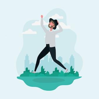 Hombre joven con barba y sombrero saltando en el personaje del parque