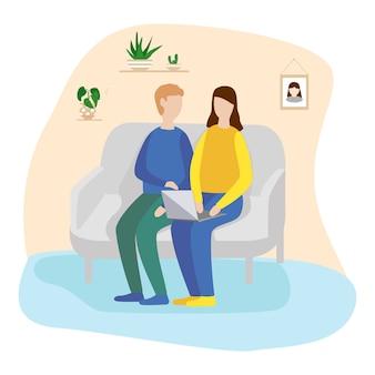 Hombre joven y mujer están sentados en el sofá en casa