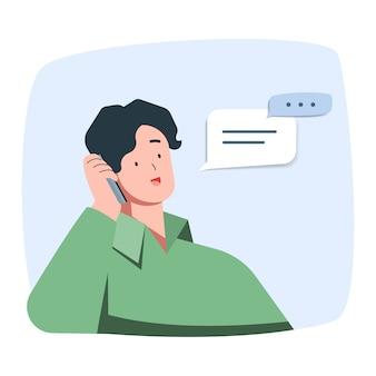 El hombre joven está sonriendo hablando en el teléfono