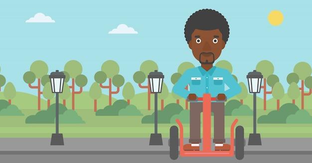 Hombre montado en scooter eléctrico.