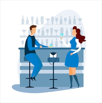 Hombre y mujer bebiendo y hablando en barra de bar