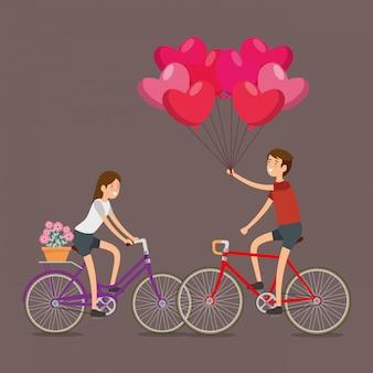 Hombre y mujer celebran el día de san valentín en bicicleta