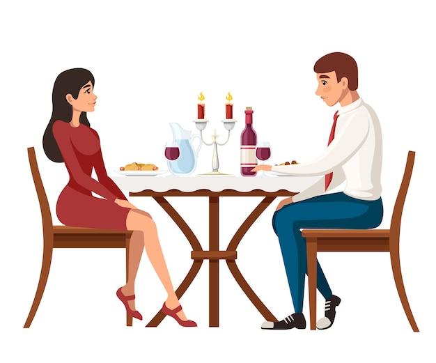 Hombre y mujer en cita en restaurante.