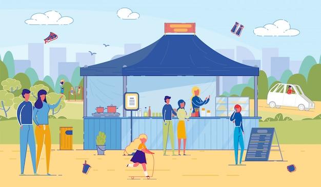 Hombre y mujer compran comida rápida en el puesto de comida callejera