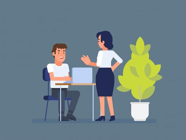Un hombre y una mujer discuten el proyecto.