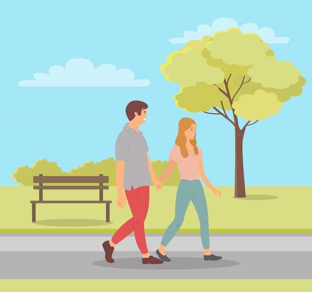 Hombre y mujer enamorados, adolescentes en park spring