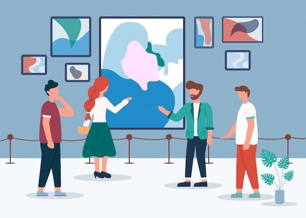 Hombre mujer en la galería de arte mira pintura abstracta