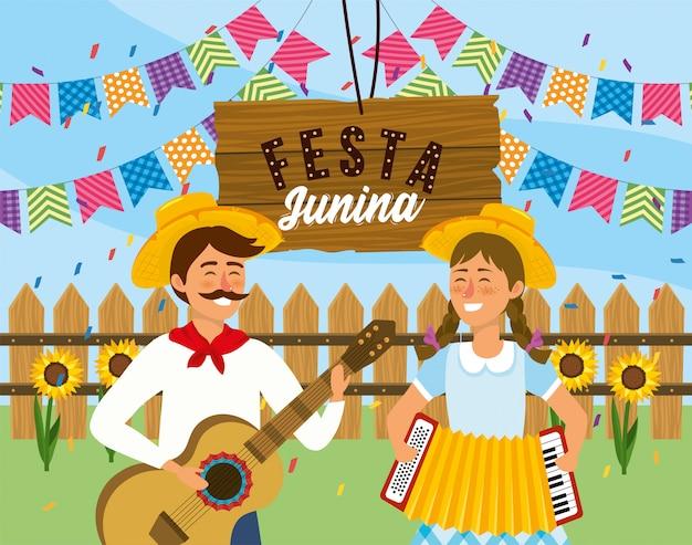 Hombre y mujer con guitarra y acordeón a festival.