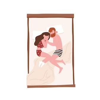 Hombre y mujer joven acostados cara a cara en la cama y durmiendo en posición fetal