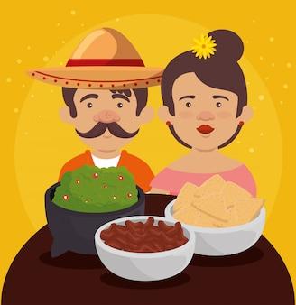 Hombre y mujer mexicana con comida tradicional