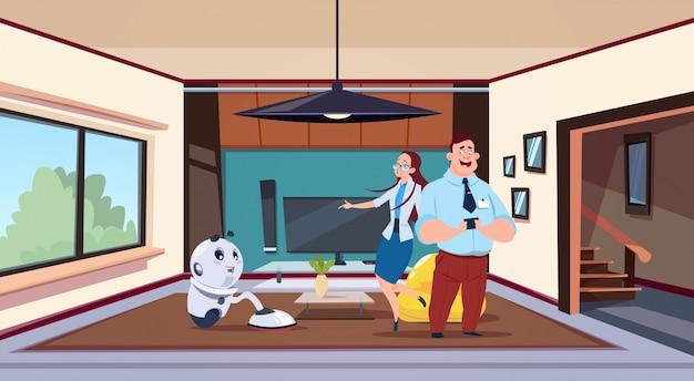 Hombre y mujer mirando robot ama de casa limpieza de sala de estar