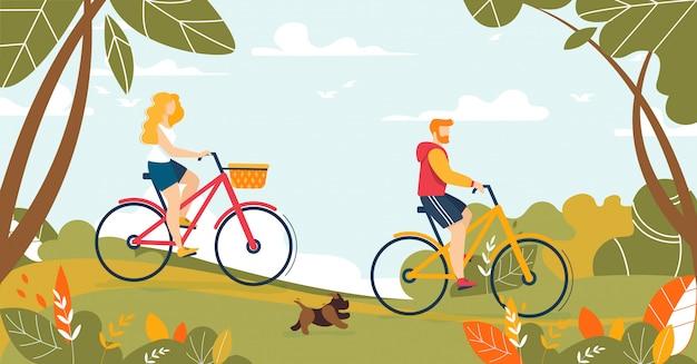 Hombre y mujer pareja montando bicicleta en el bosque