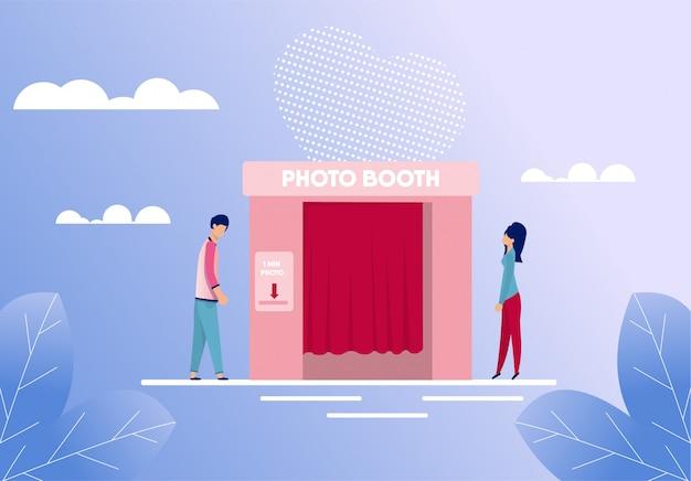 Hombre y mujer de pie cerca de photo booth cartoon