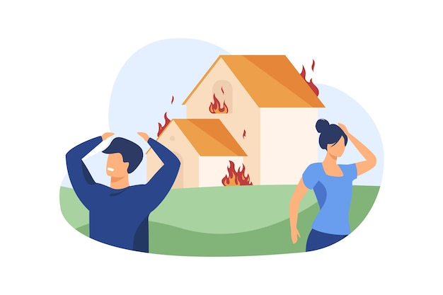 Hombre y mujer de pie fuera de la casa en llamas.