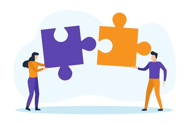 Hombre y mujer con piezas de un rompecabezas trabajando juntos. concepto de trabajo en equipo