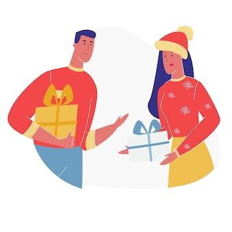 Hombre y mujer presentando regalos el uno al otro