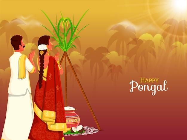 Hombre y mujer del sur de la india adorando al sol en ocasión del festival pongal