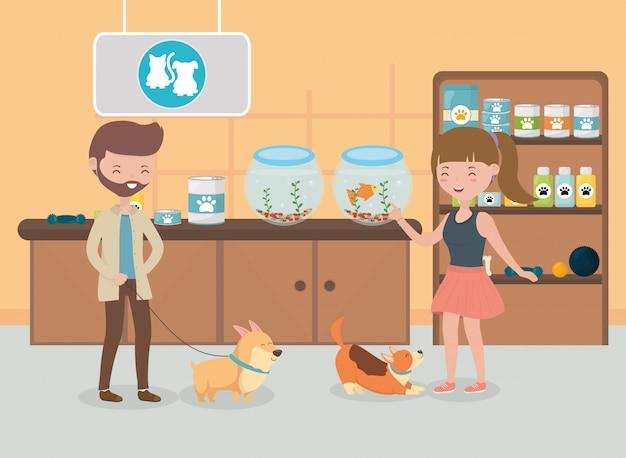 Hombre y mujer con sus perros en el veterinario cuidado de mascotas