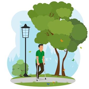 Hombre con muletas caminando en el parque en la naturaleza.