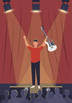 Hombre músico tocando la guitarra en el centro de atención en el escenario