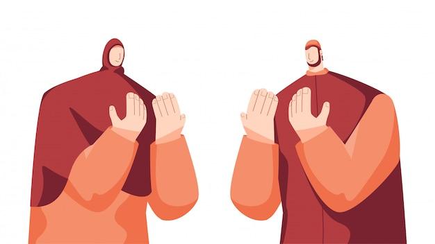 Hombre musulmán y mujer haciendo oración