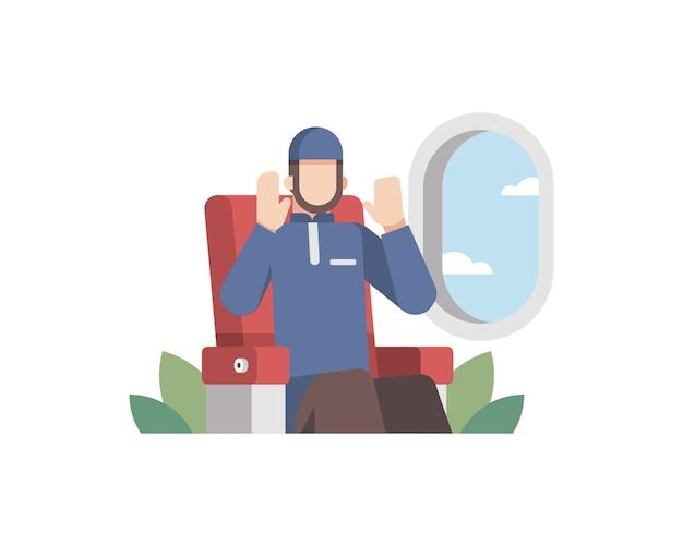 Hombre musulmán rezar en un avión