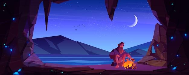Hombre náufrago solo en cueva en isla deshabitada