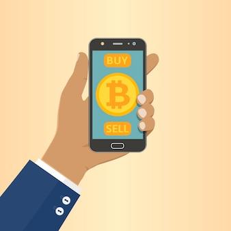 Hombre de negocios afroamericano mantenga el teléfono con el símbolo de bitcoin en la pantalla de la aplicación móvil