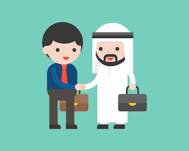 El hombre de negocios árabe lindo sacude las manos
