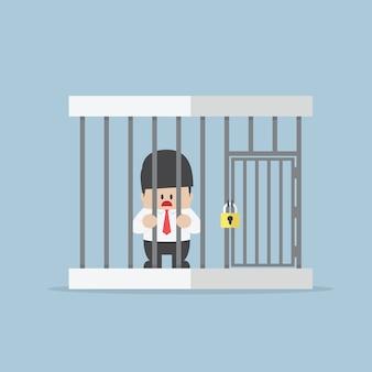 Hombre de negocios atrapado en una jaula