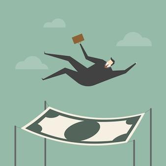 Hombre de negocios cayendo sobre un billete