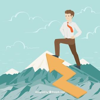 Hombre de negocios en la cima de una montaña