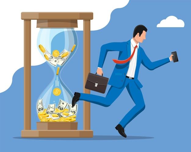 El hombre de negocios corre rápido con la corbata y el maletín agitando cerca del reloj de arena. gestión del tiempo.