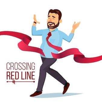 Hombre de negocios cruzando la línea de la cinta roja