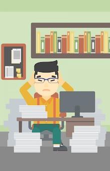Hombre de negocios en la desesperación sentado en la oficina