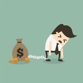 Hombre de negocios encadenado a una bolsa de dinero