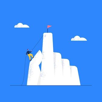 Hombre de negocios intentando subir al pico de la montaña con el concepto de objetivo de cuerda