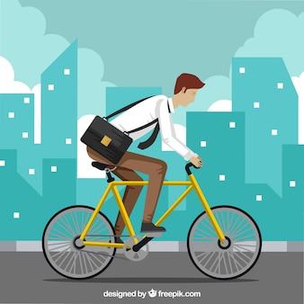 Hombre de negocios moderno montando en bicicleta