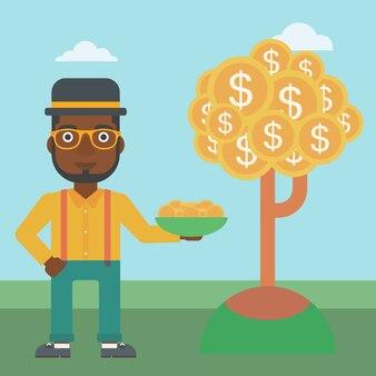 Hombre de negocios que captura monedas de dólar