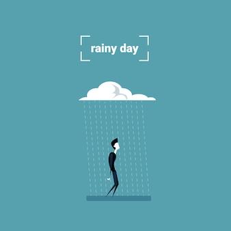 Hombre de negocios que se coloca bajo concepto del problema del día lluvioso de la nube de lluvia
