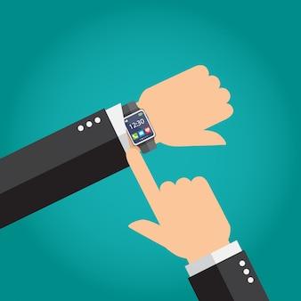 Hombre de negocios que muestra el tiempo en su reloj inteligente