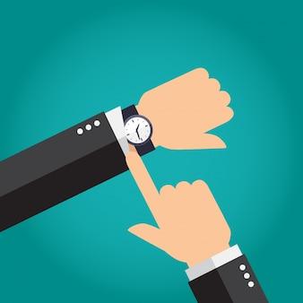 Hombre de negocios que muestra el tiempo en su reloj moderno