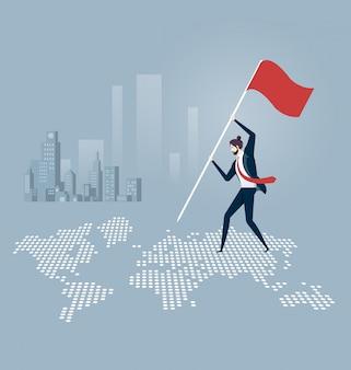 Hombre de negocios que pone una bandera encima de un mapa del mundo