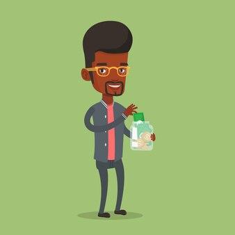 Hombre de negocios que pone el dinero del dólar en el tarro de cristal.