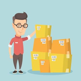 Hombre de negocios revisando cajas en almacén.