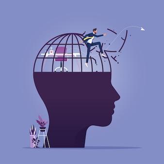 Hombre de negocios rompiendo la jaula en la cabeza grande humana, piensa en el concepto de mentalidad de crecimiento