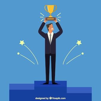 Hombre de negocios sonriente con un trofeo