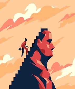 Un hombre de negocios está subiendo las escaleras hacia el pico