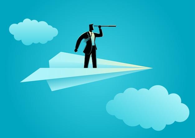 Hombre de negocios con telescopio en avión de papel