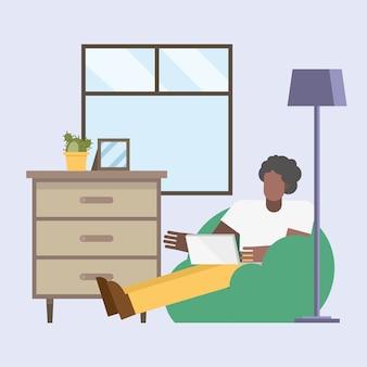 Hombre negro con computadora portátil trabajando en puf desde el diseño del hogar del tema del teletrabajo ilustración vectorial